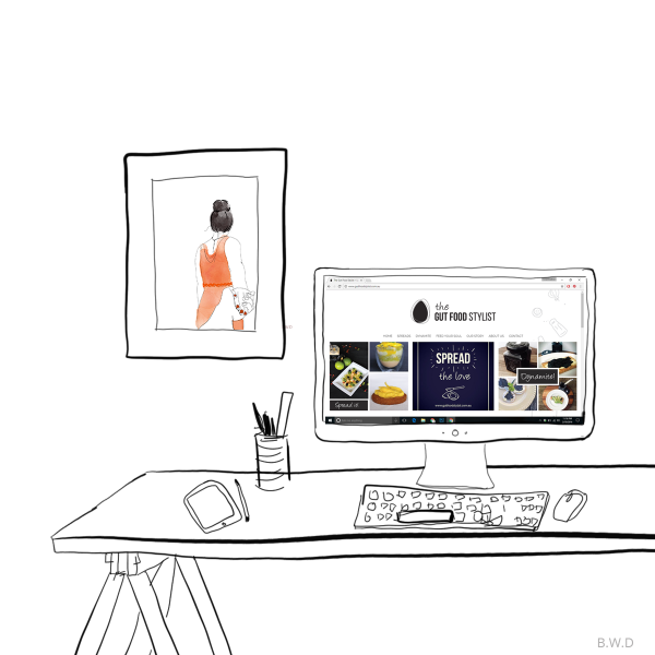 The Gut Food Stylist website displayed on an illustrated desk